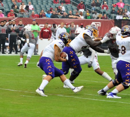 Darius Pinnix carries for East Carolina on Saturday. (Photo by Al Myatt)