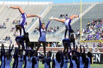 The ECU cheerleaders demonstrate that not all of the talented performers were in helmets and shoulder pads. (Photo by Al Myatt)