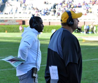 Scottie Montgomery and defensive coordinator David Blackwell follow the action in Saturday's AAC matchup. (Photo by Al Myatt)