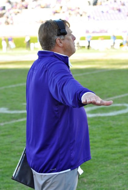 Special teams coordinator Kirk Doll signals from the sideline on Saturday. (Photo by Al Myatt)