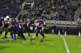 True freshman quarterback Holton Ahlers completes a pass in a 55-21 win over UConn on senior night. The Greenville product accounted for five touchdowns - four through the air and one on the ground. (Photo by W.A. Myatt)