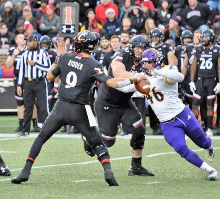 Chance Purvis (46) brings pressure but Cincinnati quarterback Desmond Ridder gets a pass away. (Photo by Al Myatt)