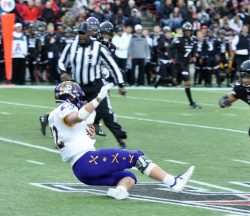 True freshman Holton Ahlers slides after a gain for the Pirates. (Photo by Al Myatt)
