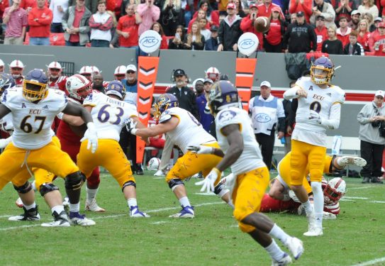 East Carolina quarterback Reid Herring throws a backwards pass in the flat to Anthony Scott, who couldn't make the catch but was able to recover the ball.