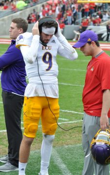 Reid Herring gets on the headset on the sideline after an ECU possession faltered.