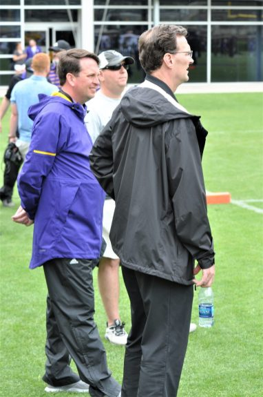 Pirate Club director Phillip Wood (left) and athletic director Jon Gilbert had their rain jackets on but the spring game got a break on the weather. (Photo by Al Myatt)