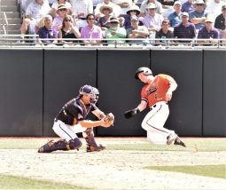 ECU catcher Jake Washer (left) makes a tag out at the plate. (Photo/Dunn Area Sports/Paul Burgett)