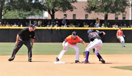 ECU's Chandler Jenkins tries to elude a tag on Monday afternoon. (Photo/Dunn Area Sports/Paul Burgett)