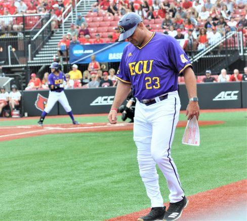 Pirates coach Cliff Godwin has his chart in hand as ECU0 bats at Louisville on Friday. (Photo by Al Myatt)