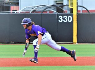 Alec Burleson of East Carolina starts a head-first slide into second base. (Photo by Al Myatt)