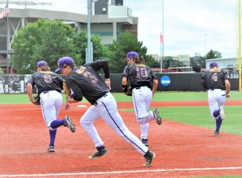 The Pirates take the field defensively during Saturday's game at Louisville. (Photo by Al Myatt)
