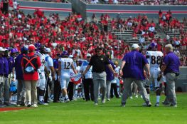 ECU head coach Mike Houston looks for answers from freshman Jsi Hatfield after an unnecessary roughness special teams penalty. (W.A. Myatt photo)