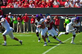 Tyler Snead fields a kickoff in Saturday afternoon's season opener against North Carolina State. The Raleigh product was impressive in a punt and kick return role for the Pirates (W.A. Myatt photo)