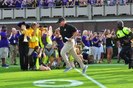 First year ECU head coach Mike Houston runs out of the tunnel for the first time under the lights at Dowdy-Ficklen stadium on Saturday evening. (W.A. Myatt photo)