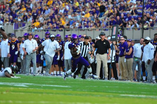 ECU wide receiver Jsi Hatfield looks downfield after catching a pass from quarterback Holton Ahlers. (W.A. Myatt photo)