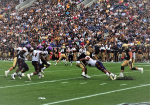 ECU defensive end Chance Purvis stops Navy quarterback Malcolm Perry