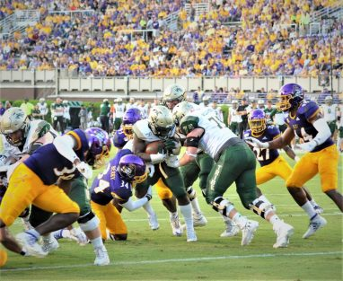 Myles Berry (34) makes a stop for the Pirates from his inside linebacker position (Photo by Al Myatt)