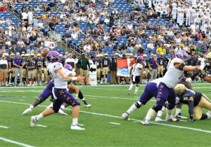 Sophomore quarterback Holton Ahlers passes for the Pirates against Navy