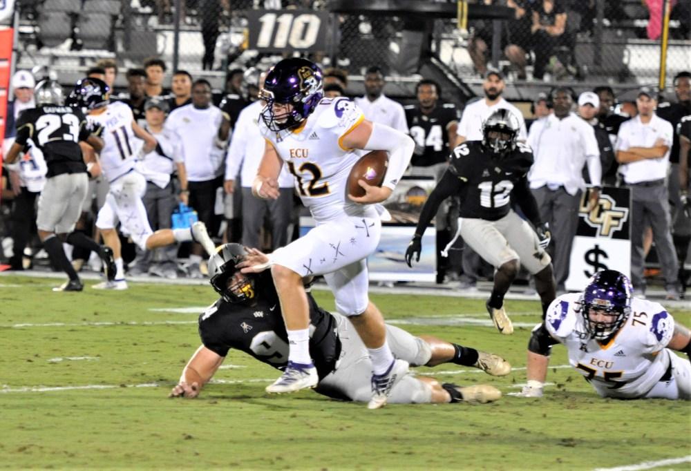 East Carolina quarterback Holton Ahlers keeps on a designed run (Al Myatt photo)