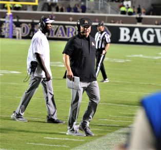First-year East Carolina coach Mike Houston had a short week before the Temple game. The Pirates don't play again until Oct.19 at Central Florida. (Photo by Al Myatt)