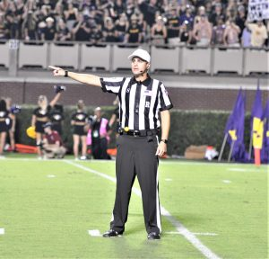 Referee Adam Savoie indicates a penalty against Temple. The Owls drew eight flags for 50 yards in the first half while ECU was not assessed a penalty in the opening 30 minutes. (Photo by Al Myatt)