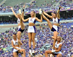 The ECU cheerleaders get up to lift the spirits of Pirate Nation on Saturday. (Photo by Al Myatt)