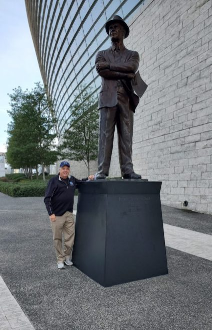Brian Bailey visits the Tom Landry statue at AT&T Stadium. (submitted photo)