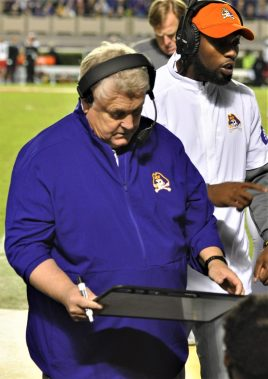 Defensive coordinator Bob Trott consults his clipboard after a defensive stop (Al Myatt photo)