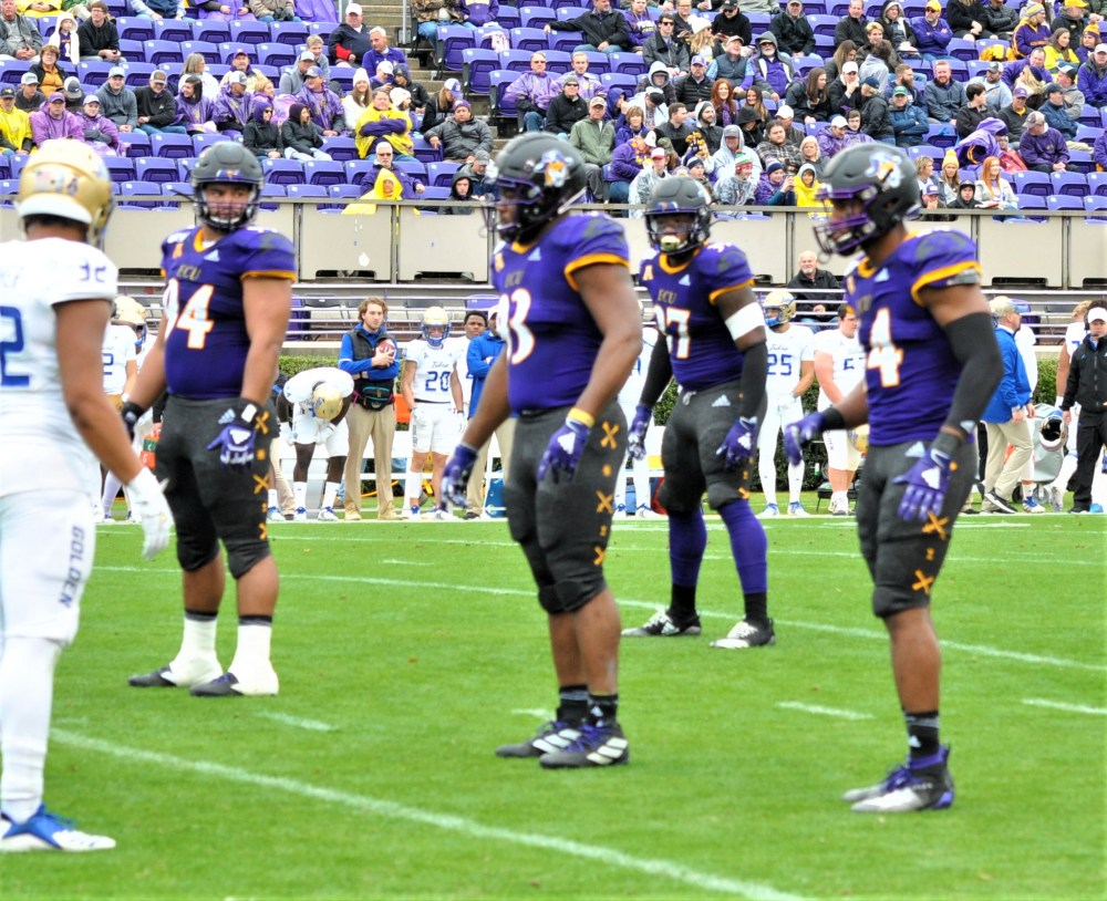 From left, senior defensive linemen Alex Turner, Jalen Price and Kendall Futrell played their last game for the Pirates. (Photo by Al Myatt)