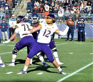 Holton Ahlers goes to the air for the Pirates in ECU's last road game of the season. (Photo by Al Myatt)