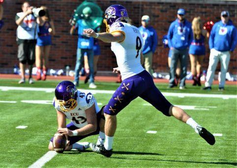 Jonn Young spots the ball for an ECU conversion kick by Jake Verity. (Photo by Al Myatt)