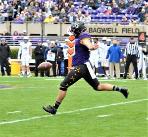 Jonn Young swings his foot on a punt for the Pirates. (Photo by Al Myatt)