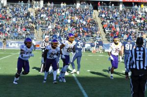 Members of the ECU coverage unit head for the sideline after a stopping a kickoff return at the UConn 16-yard line. (Photo by Al Myatt)