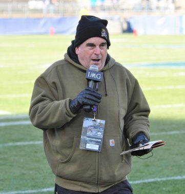 Sideline reporter Marty Feurer of the Pirate radio netork was dressed for a chilly day in East Hartford. (Photo by Al Myatt)