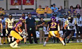 Keaton Mitchell returns a kickoff as Tyler Snead looks to block. (Al Myatt photo)