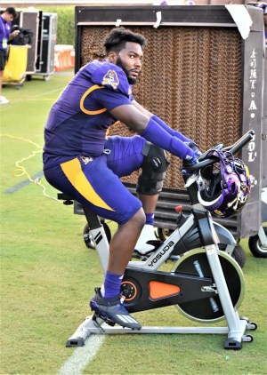 Immanuel Hickman stays loose by pedaling the stationary bike. (Al Myatt photo)