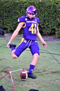 Place kicker Owen Daffer practices on the sideline. (Al Myatt photo)