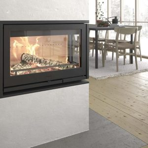 Contura i8 wood burning fire inserted into a wall