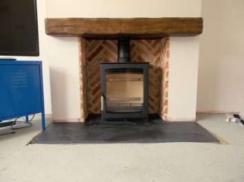 Parkray Aspect 5 Wood burning stove, slate hearth and rustic beam installation