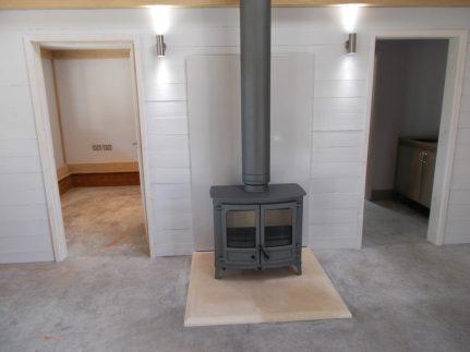 Charnwood Island 2 wood burning stove installation in chimney breast