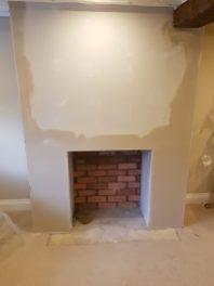 False chimney breast before wood burning stove by Bonfire