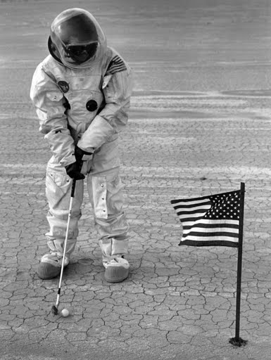 "Man on the moon? Think again. This photo was shot by my friend Richard Menzies for an edition of The Salt Flat News that addressed Wendover's bid for a NASA spaceport. His editor, Richard Goldberger, is wearing the space suit. Said Menzies, ""We were ""recreating"" Alan Shepard's lunar golfing stunt, except that his was a chip shot and ours was a short putt. Funny thing is, many people thought it was an authentic NASA photo."""