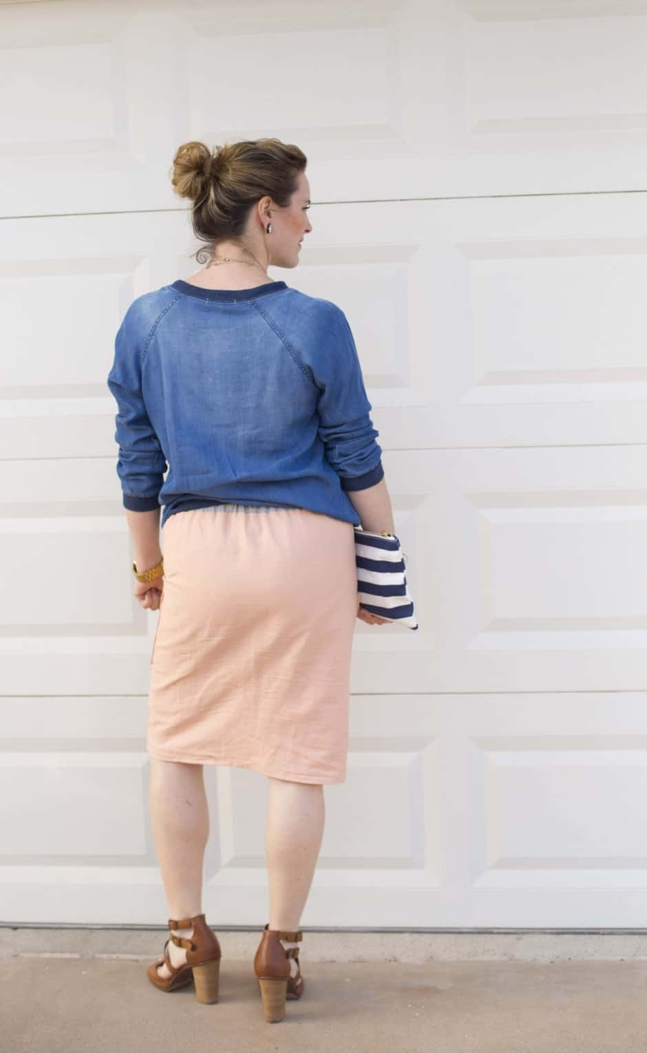 This skirt sewing tutorial is quick, easy and beginner friendly! Learn how to make  DIY flat-front skirt in just a couple of hours and with just a yard of fabric!