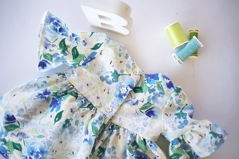 This simple pattern hack will show you how to make a darling on-trend bell sleeve baby dress DIY for the little bundle of joy! Take a break from pink by using this beautiful blue and green floral fabric; it's the perfect addition to any little girls' wardrobe. Read on for the ruffle sleeve tutorial and details on this gorgeous quilting cotton.eautiful blue and green floral fabric; it's the perfect addition to any little girls' wardrobe. Read on for the ruffle sleeve tutorial and details on this gorgeous quilting cotton.