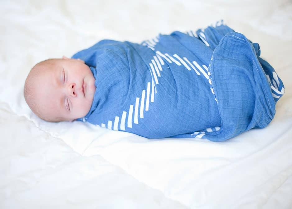 swaddled tiny infant