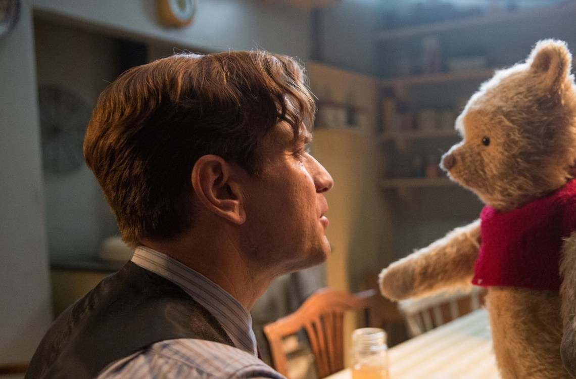 Christopher Robin (Ewan McGregor) and his longtime friend Winnie the Pooh in Disney's CHRISTOPHER ROBIN. Photo Credit: Laurie Sparham. © 2018 Disney Enterprises, Inc. All Rights Reserved.