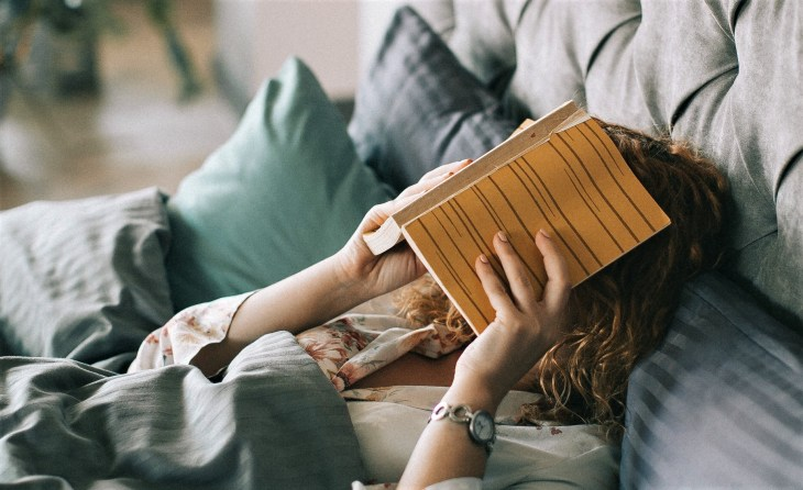Woman covering her face with a book - effect of alliteration guide