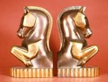 May 1, 2013. Geometric horse.  gray metal with bronzed trophy-like finish. Height 8.5 inches.  Marked Champion Products and Phillip DiNapoli (artist).  Art Deco style. The rounded areas flattened into planes are a cubist touch. Circa 1930  .