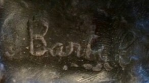 Illegible signature of Artist or foundry on reading monk bookend.