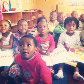 South African students receive books on Int'l Book Giving Day.